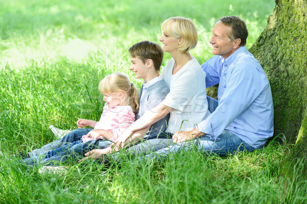Happy family relaxing in park Stock photo © stockyimages