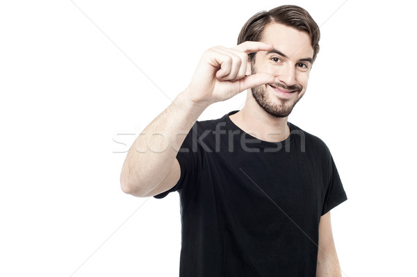Man showing small amount with fingers Stock photo © stockyimages