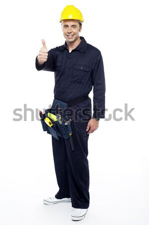 Industrial engineer resting his hands on stepladder Stock photo © stockyimages