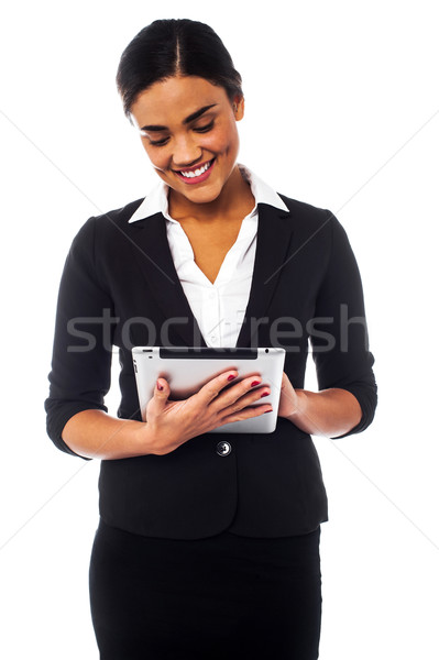 Company manager browsing on tablet pc Stock photo © stockyimages