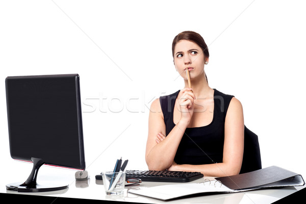 Lady thinking of a solution for client's query Stock photo © stockyimages