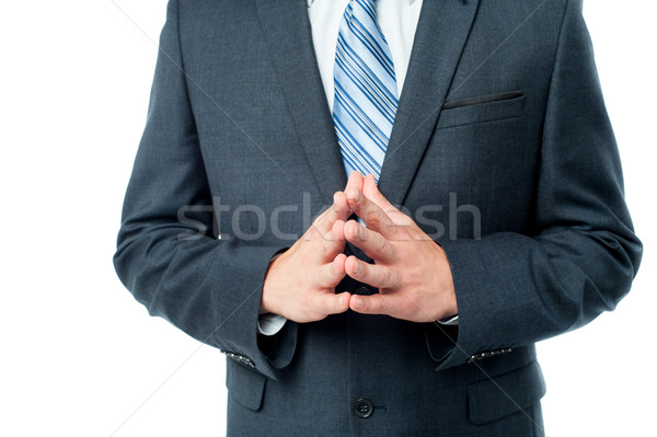 Clasped hands of businessman Stock photo © stockyimages