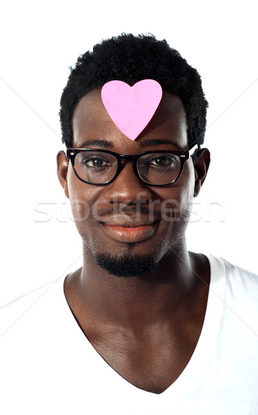 Closeup of an african man with pink paper heart on forehead Stock photo © stockyimages