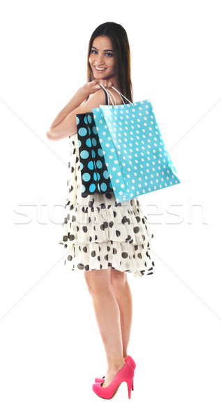 Stunning teenager carrying shopping bags Stock photo © stockyimages