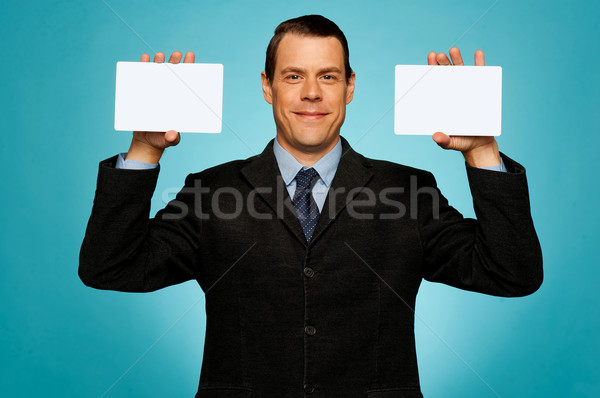 Businessman showing two blank white placards Stock photo © stockyimages
