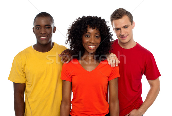 College friends posing in casuals. Cheerful group Stock photo © stockyimages