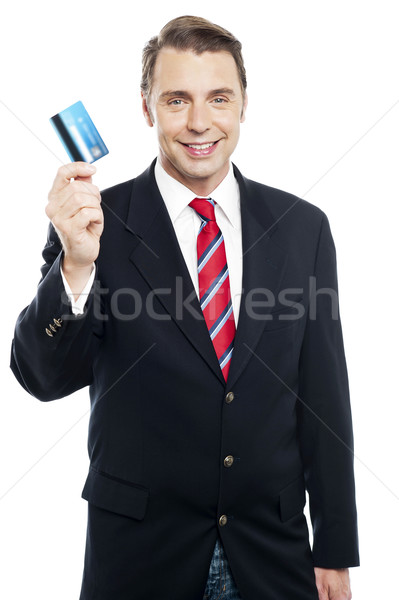 An entrepreneur showing debit card to camera Stock photo © stockyimages