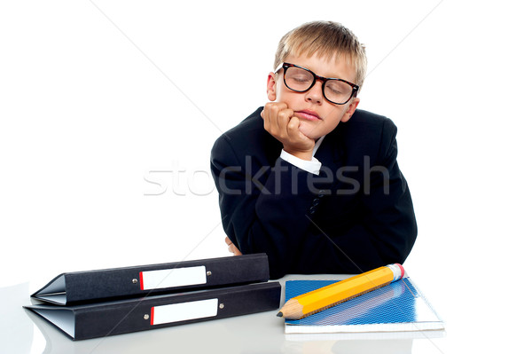 School boy in glasses dozing off Stock photo © stockyimages