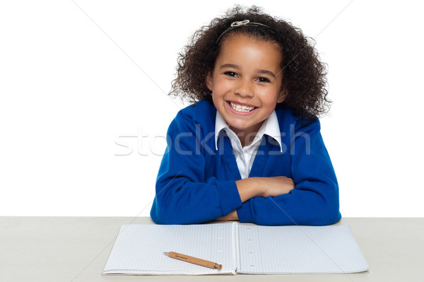 Enthusiastic student paying attention in the class Stock photo © stockyimages