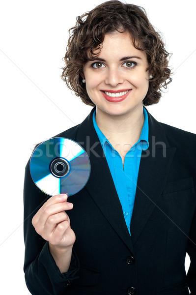 Charming corporate lady holding data disc Stock photo © stockyimages