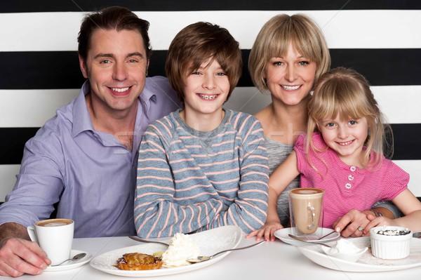 Family enjoying breakfast at restaurant Stock photo © stockyimages