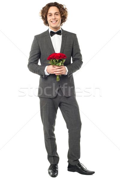 Bruidegom smoking poseren boeket bos Stockfoto © stockyimages
