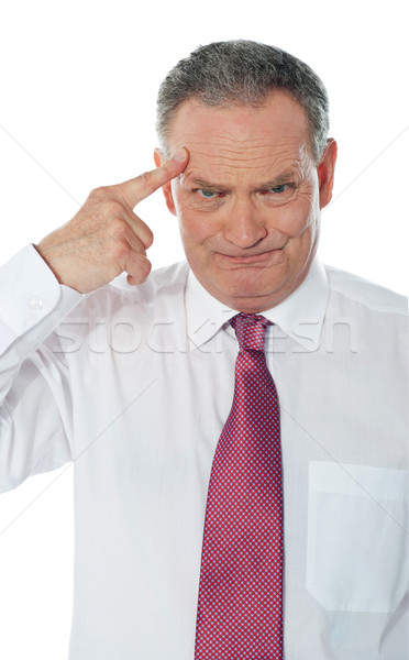 Confused matured corporate man Stock photo © stockyimages