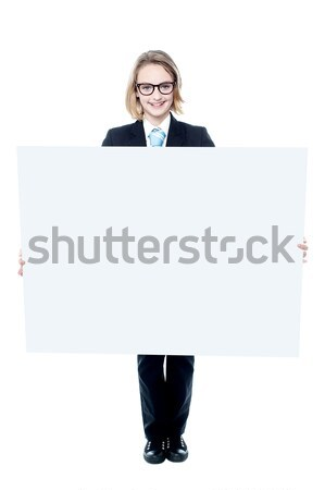 Handsome boy showing an empty billboard Stock photo © stockyimages