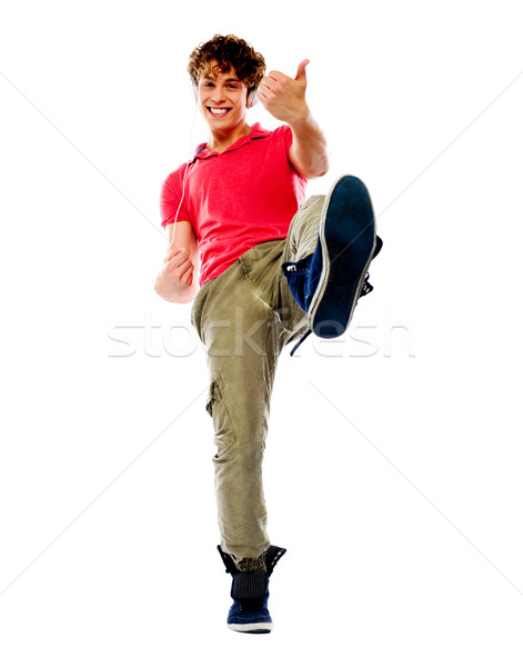 Smart guy playing imaginary guitar Stock photo © stockyimages