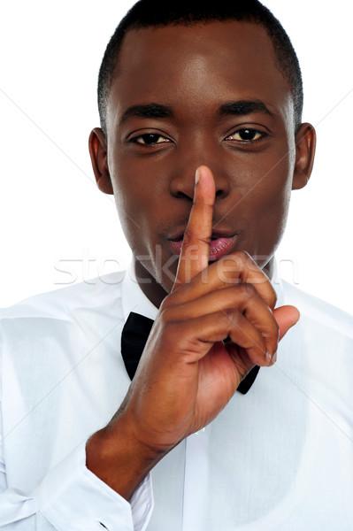 Siyah adam sessizlik jest parmak dudaklar Stok fotoğraf © stockyimages