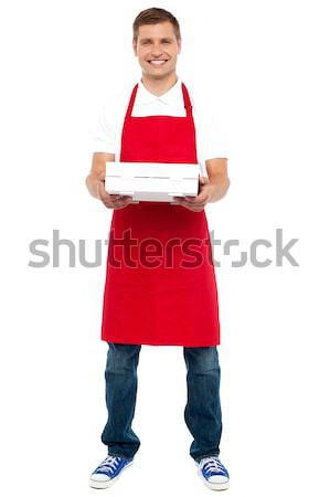 Full length portrait of male chef holding pie box Stock photo © stockyimages