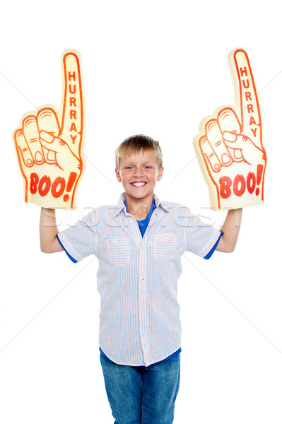 Energetic young boy showing true fan spirit Stock photo © stockyimages