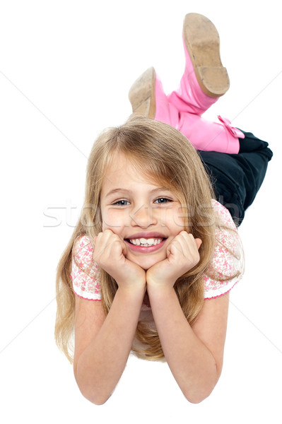 Cheeky young girl posing for a portrait Stock photo © stockyimages