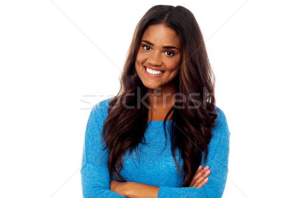 Young girl posing with her arms crossed Stock photo © stockyimages