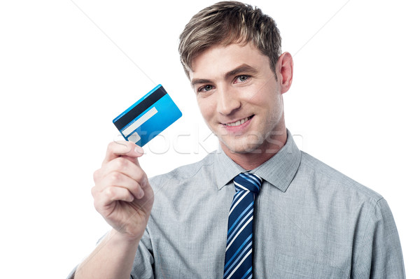 Smiling corporate guy showing his debit card Stock photo © stockyimages