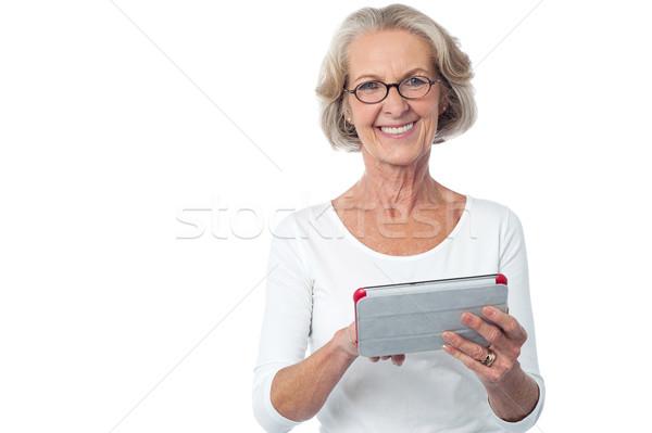 興味深い 幸せ シニア 女性 技術 ストックフォト © stockyimages