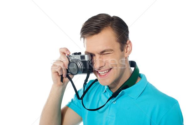 Młodzieży fotograf zdjęcia człowiek szczęśliwy Zdjęcia stock © stockyimages