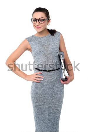 Smiling young female carrying shopping bags Stock photo © stockyimages