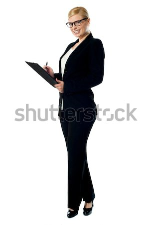 Businesswoman with a clipboard Stock photo © stockyimages