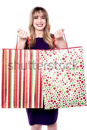 Excited young shopaholic woman posing Stock photo © stockyimages