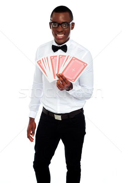 Hombre poco cartas aislado blanco Foto stock © stockyimages
