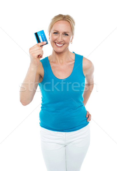 Trendy middle aged woman showing credit card Stock photo © stockyimages
