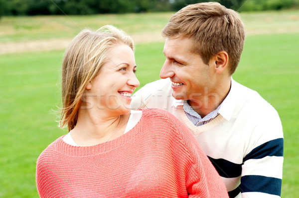Couple admiring each other and smiling heartily Stock photo © stockyimages