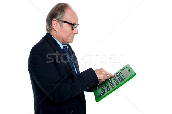 Szándék néz igazgató dolgozik számológép kisajtolás Stock fotó © stockyimages