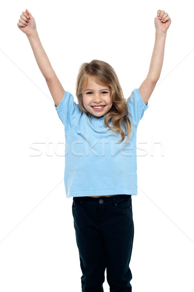 Cute caucasian girl celebrating with raised arms Stock photo © stockyimages