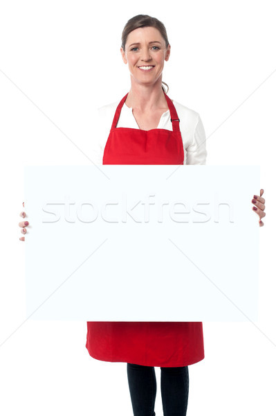 Lady wearing apron holding white blank ad board Stock photo © stockyimages