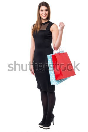 Beautiful young woman with shopping bags Stock photo © stockyimages