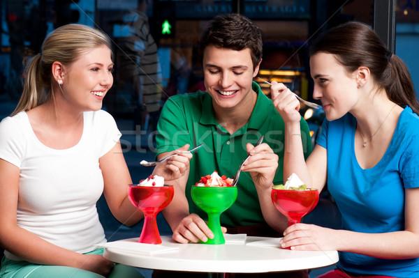 Tre amici allettante dessert giorno Foto d'archivio © stockyimages