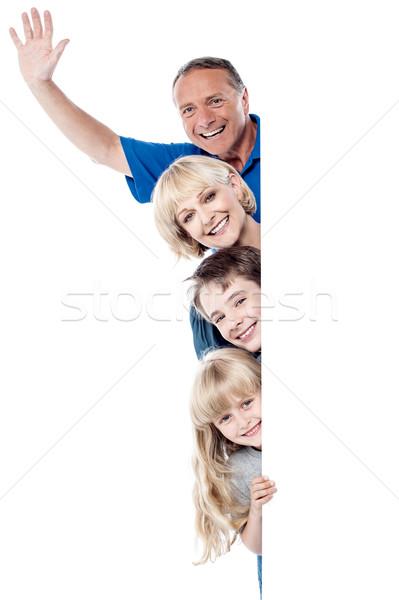 радостный семьи четыре за улыбаясь Сток-фото © stockyimages