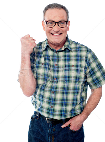 Excited elderly male dressed in casuals Stock photo © stockyimages