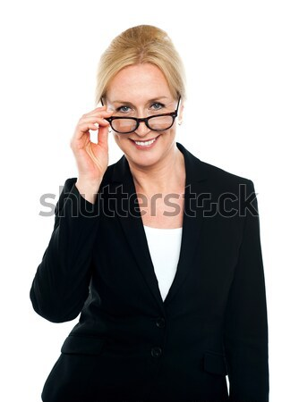 Female secretary taking a closer look at you Stock photo © stockyimages
