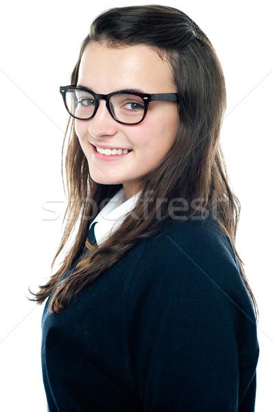Oldalnézet imádnivaló tinédzser visel szemüveg közelkép Stock fotó © stockyimages