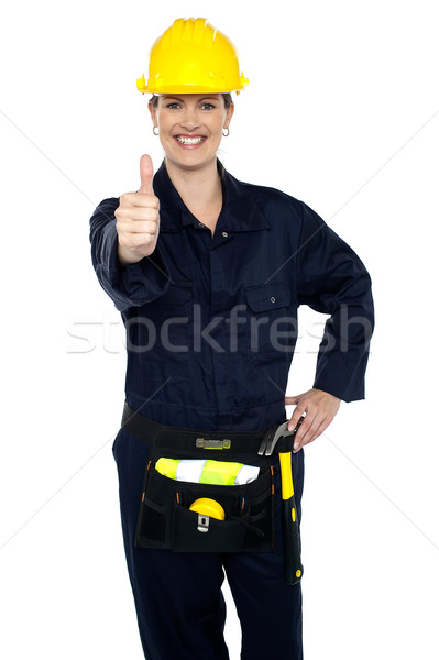 Stock photo: Confident lady worker showing thumbs up