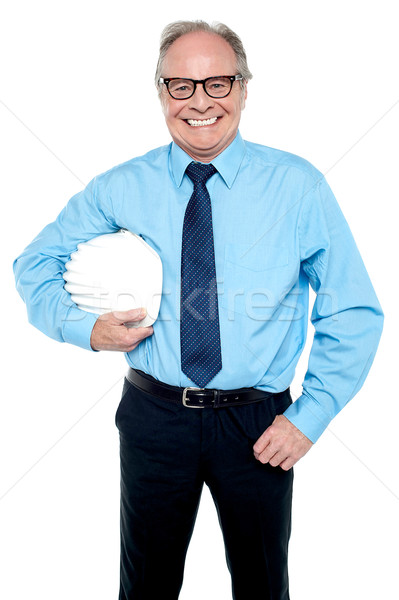 Portrait of an architect holding a safety helmet Stock photo © stockyimages