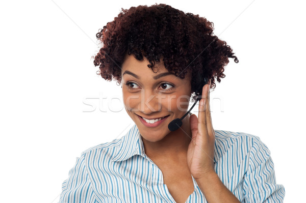 Casual shot of a call centre executive looking away Stock photo © stockyimages