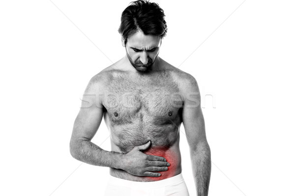 Young man holding his sick stomach Stock photo © stockyimages