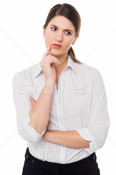 Lady concerned about her business growth Stock photo © stockyimages