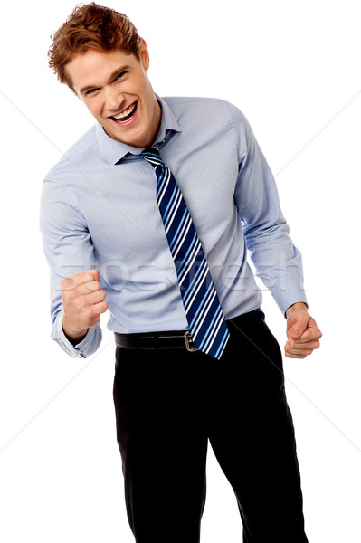 Enthusiastic young business executive Stock photo © stockyimages