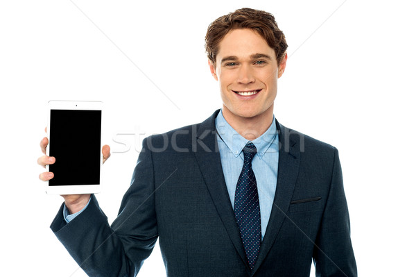 Guy presenting newly launched tablet device Stock photo © stockyimages