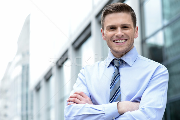 Young corporate man posing confidently Stock photo © stockyimages